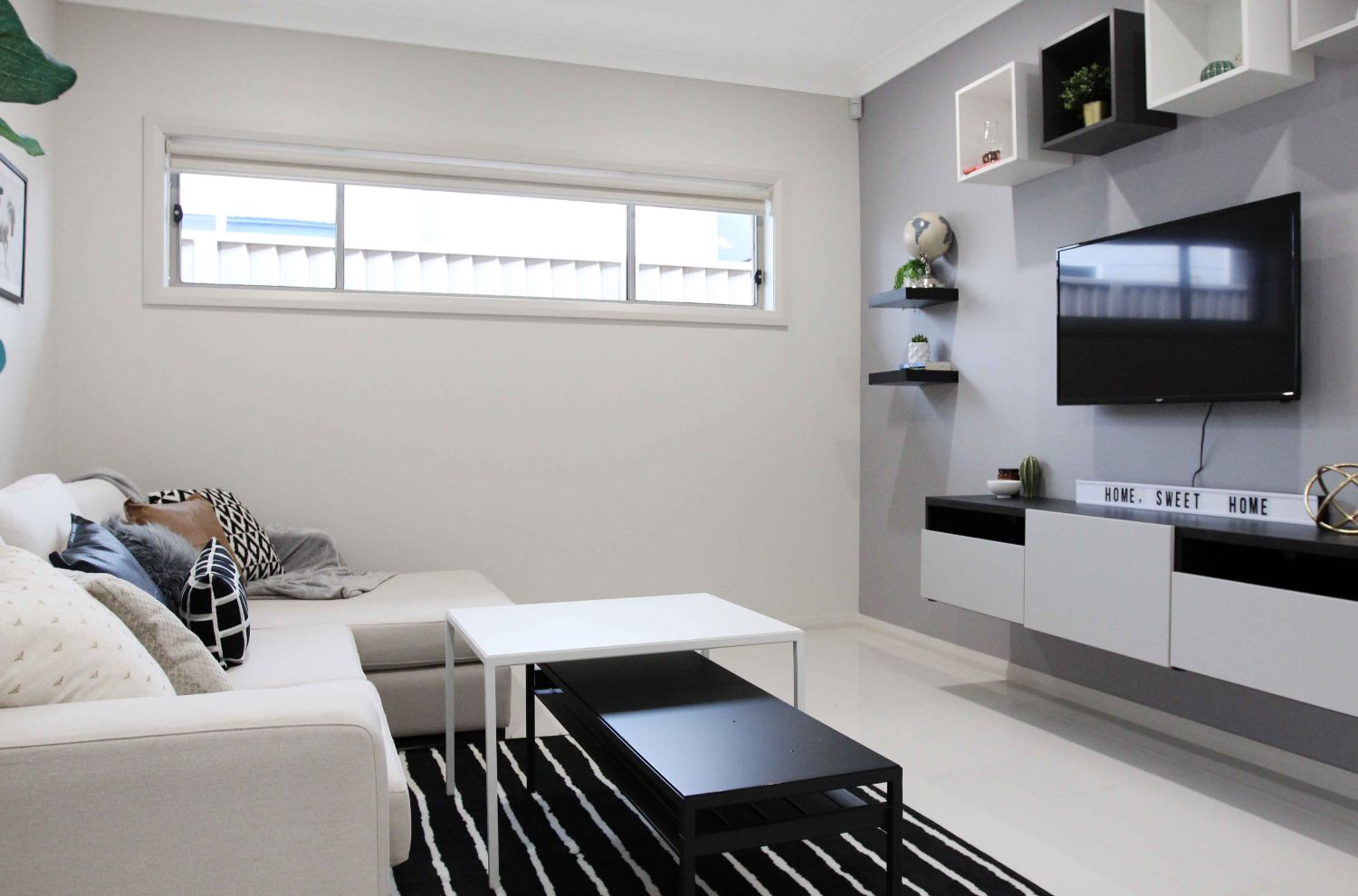 Tv room decoration with sofa and table