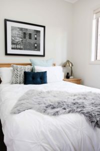 Big picture frame behind bed