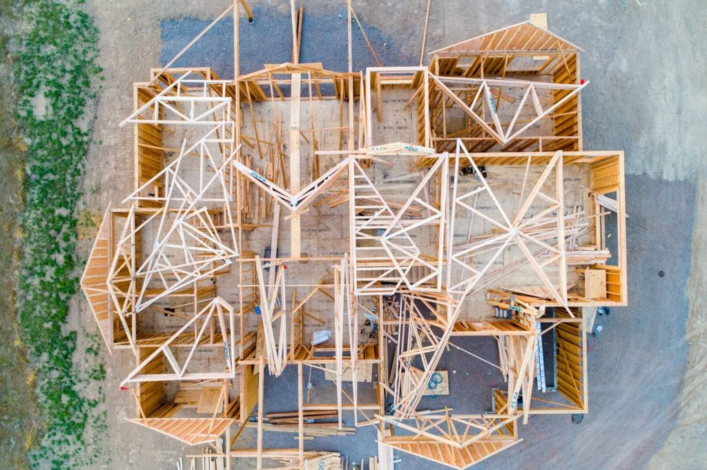 6 Stages Of Building A House Aerial View Of House Framework